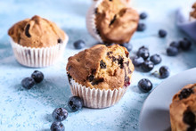 Tasty Blueberry Muffins On Col...