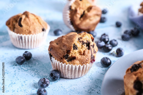 Fotografie, Obraz  Tasty blueberry muffins on color background