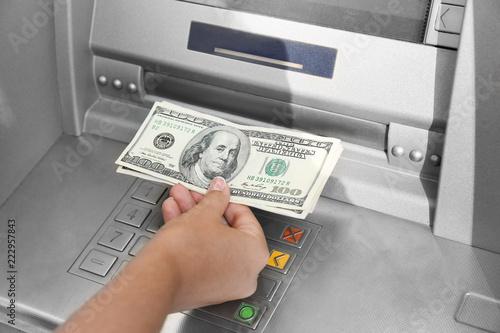 Fototapeta Woman withdrawing money from ATM, closeup obraz