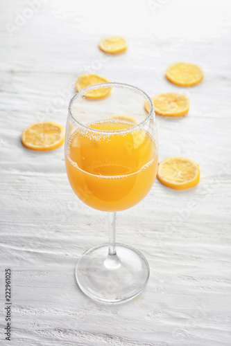 Keuken foto achterwand Sap Glass of fresh lemon juice on white wooden table