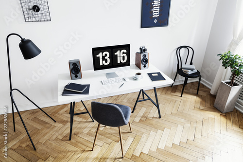 Obraz High angle view of a bright home office interior for a creative professional with black and white furniture and herringbone parquet floor. Real photo. - fototapety do salonu