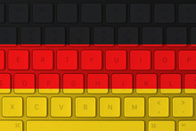 German Flag And Computer Keyboard In The Background. Germany Flag