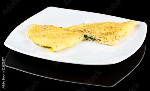 Tuinposter Buffet, Bar Omelet with organic spinach, cheese and mushrooms isolated on black background