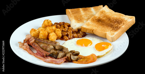 Full english breakfast isolated on black background