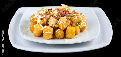 Foto op Aluminium Buffet, Bar Totchos -Tater tots isolated on black background