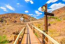 School Bridge And Chapel Church In The Calico Mountains Of Mojave Desert Of Calico Old Mining Ghost Town Near Barstow In California, USA. Western Cowboy Settlement Historic Park And Travel Destination
