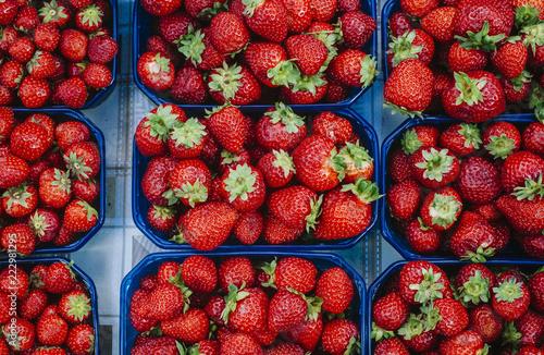 Fotografering  Fresh strawberries sold on the market.