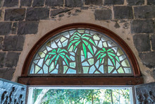 Stained Glass Window Above The Front Door To The Church Of The Primacy Of Saint Peter Located On The Shores Of The Sea Of Galilee - The Kinneret