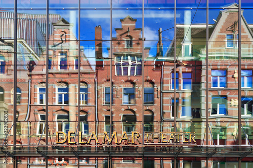 Facade with reflection of the DeLaMar theater in Amsterdam, The Netherlands