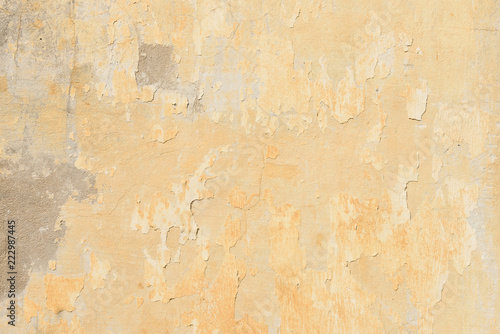 Wall Murals Old dirty textured wall texture of old peeling yellow plaster