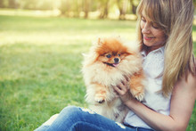Pretty Young Woman Having Fun With Her Dog, Copy Space For Your Text