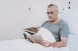 Rehabilitation in Clinik. Aged Man in White Room.