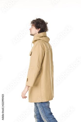 Fotografie, Obraz  Man in raincoat making step
