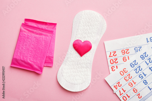 sanitary pads and calendar on pink background, flat lay, top view Canvas Print