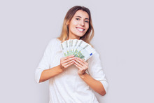 Woman Young Adult Happy And Emotional With A Fan Of European Euro Money In The Studio
