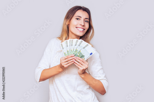 Fototapeta Woman young adult happy and emotional with a fan of European Euro money in the Studio obraz