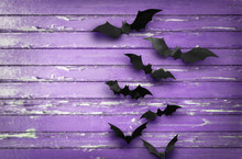 Halloween, Decoration And Scary Concept - Black Bats Flying Over Ultra Violet Shabby Boards Background