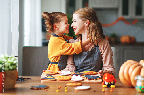 Stampa su Tela happy Halloween! family mother and daughter getting ready for   holiday and baki
