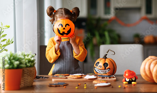happy child girl in costumes of pumpkins are preparing for  holiday Halloween Fotobehang