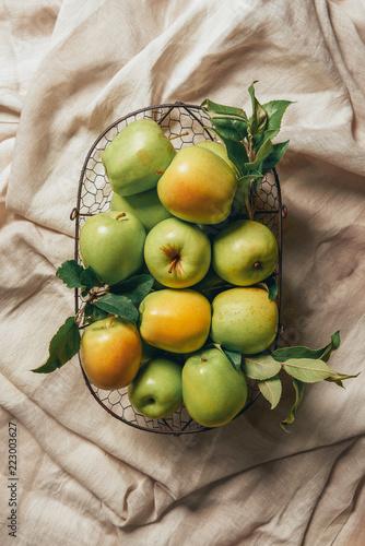 Fotografie, Obraz  green apples in metal basket on sacking cloth