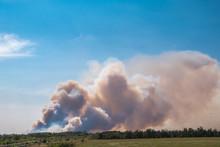 A Big Cloud Of Thick Smoke Ris...
