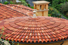 A Red Tiled Roof Over A Round Building In Palos Verdes Estates, California.