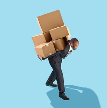Concept Of Hard Career In The Business. Flat Isometric View Of African Businessman Carring Many Boxes. Business Processes, Delivery, Logistics Concepts. Miniature People. Collage