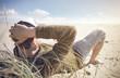 canvas print picture - Mann entspannt an der Nordsee