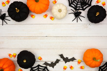 Halloween Double Border With Black, Orange And White Decor And Candy Over A White Wood Background. Top View With Copy Space.