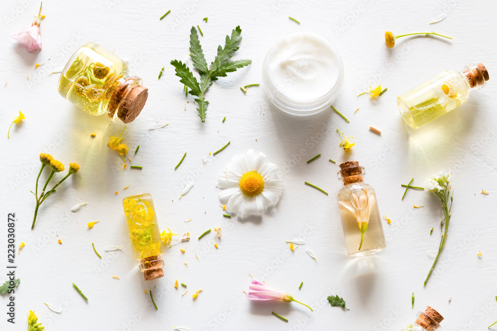 Fototapety, obrazy: natural cosmetics for face and body care from wildflowers close-up on a white background