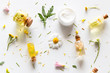 natural cosmetics for face and body care from wildflowers close-up on a white background