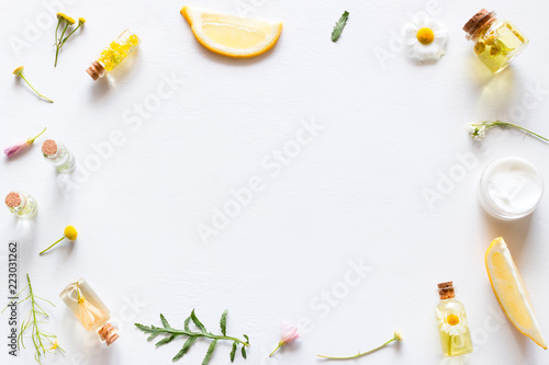 Aluminium Prints Spa background with cosmetic products for face and body care, leaves and wildflowers mockup