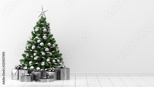 Fotografía  decorated christmas tree with gift boxes in white room