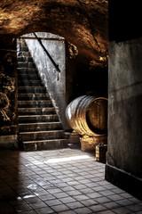 Old Wine barrel in ancient wine cellar.