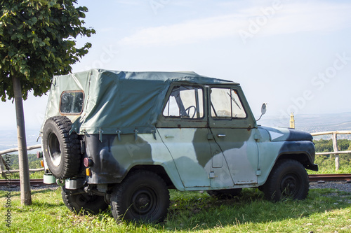 Fotografiet  Commander jeep military vehicle with landscape background