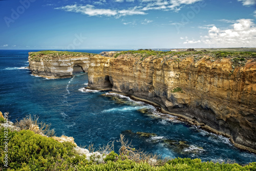 Staande foto Oceanië Victoria - Australia – rough costline with sandy beach and sunny blue sky