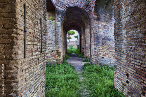 Foto op Aluminium Rudnes Street view under the ancient Roman colonnades in Ostia Antica - Rome