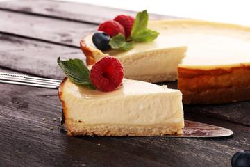 Fototapeta Homemade cheesecake with fresh raspberries and mint for dessert - healthy organic summer dessert pie cheesecake. Vanilla Cheese Cake