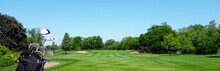 Golf Banner: A Golf Bag With Clubs On A Par Three Tee Box