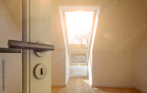 Entrance door to an apartment in the roof top floor in a ...