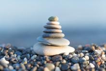 Stones Pyramid On Pebble Beach...