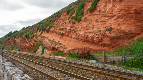 Fotografie, Tablou  red rock and railway in Dawlish Warren, Devon