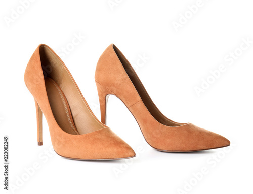 Pair of beautiful shoes on white background