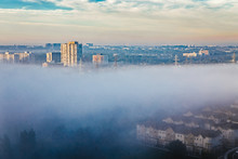Foggy Morning In Toronto City, Canada. Rays Of Early Rising Sun.  Landscape Aerial Top View With Urban Street Covered With Thick Fog. Day White Transparent Mist In Canadian Metropolia At Sunrise.
