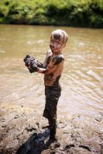 Muddy Little Boy Child Laughin...