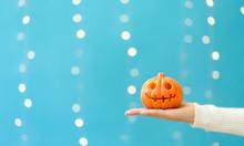 Woman Holding A Halloween Pump...