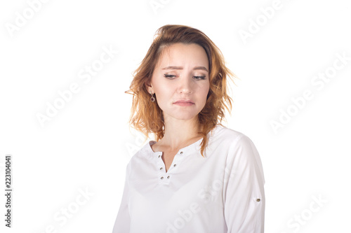 Disgusted unimpressed attractive woman with curly red hair in striped t-shirt, holding hands crossed on chest and looking with doubt and antipathy at camera, standing disappointed over white Canvas Print