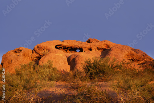 Keuken foto achterwand Verenigde Staten Papago Park known as the hole in the rock glowing red orange as sunsets over Phoenix,Arizona,USA