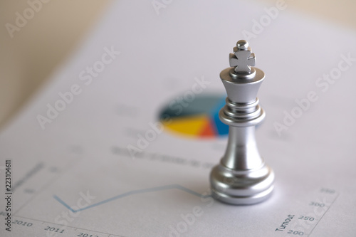 Photo  Chess on business graph for business strategy concept, success and leader