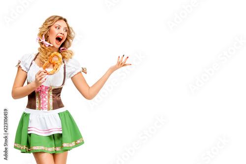 Foto op Canvas Schepselen Oktoberfest / Creative concept photo of Oktoberfest waitress wearing a traditional Bavarian costume with pretzels isolated on white background.